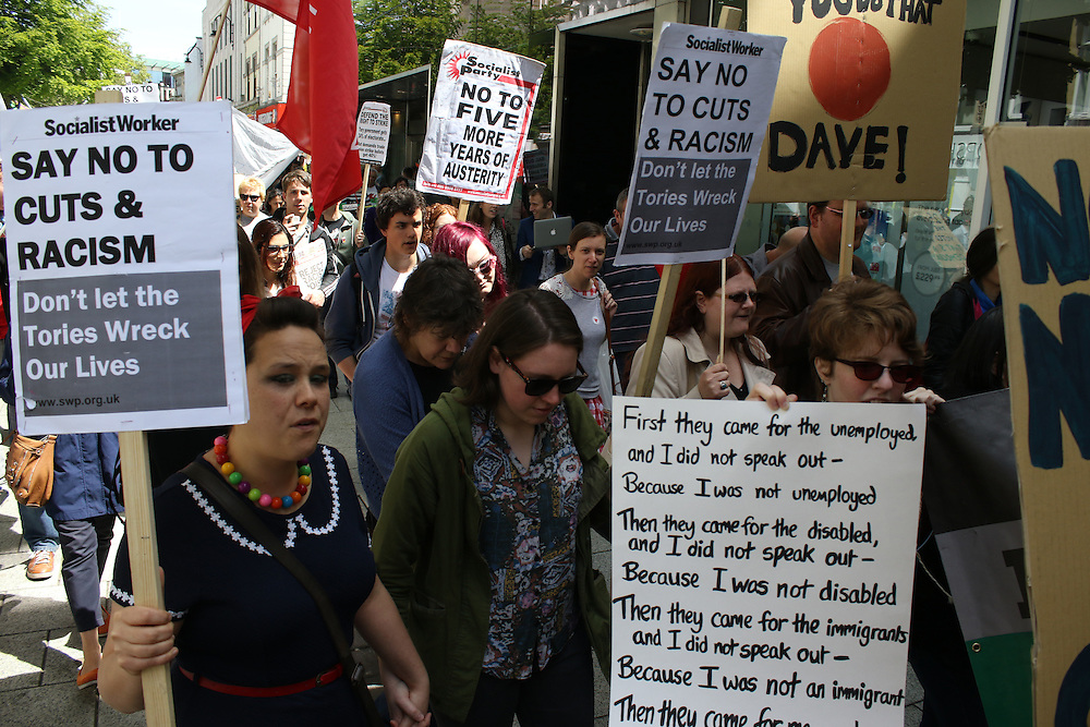 Demonstrators march through Cardiff in protest to cuts to public services
