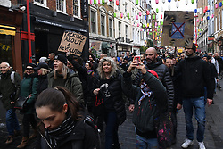 © Licensed to London News Pictures. 28/11/2020. London, UK. Protestestrrs take part in the Unite For Freedom Anti Covid-19 lockdown demonstration. Organised by the group Stand Up X, the protesters are against the current lockdown regulations and anti-vaccination for the Covid-19 disease. Photo credit: London News Pictures