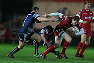 Rhys Patchell of the Scarlets tries to break past Tom McCartney of Connacht (l). Guinness Pro12 rugby match, Scarlets  v Connacht at the Parc y Scarlets in Llanelli, West Wales on Saturday 24th September 2016.<br /> pic by  Andrew Orchard, Andrew Orchard sports photography.