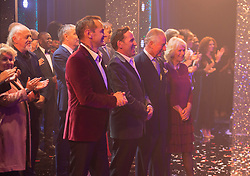 Embargoed to 0001 Tuesday November 13 The Prince of Wales and Duchess of Cornwall (centre right) on the stage after the show at the We Are Most Amused and Amazed performance at the London Palladium.