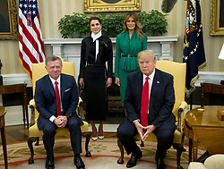 United States President Donald J. Trump meets King Abdullah II of Jordan in the Oval Office of the White House in Washington, DC on Wednesday, April 5, 2017.  Standing behind the President and  King are Queen Rania of Jordan, left, and first lady Melania Trump, right.<br /> Credit: Ron Sachs / Pool via CNP *** Please Use Credit from Credit Field ***