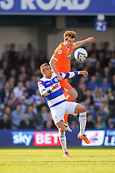 QPR's midfielder Ravel Morrison and Blackpool's midfielder Chris Basham  - Photo mandatory by-line: Mitchell Gunn/JMP - Tel: Mobile: 07966 386802 29/03/2014 - SPORT - FOOTBALL - Loftus Road - London - Queens Park Rangers v Blackpool - Championship