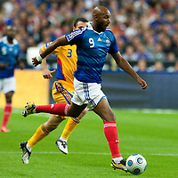 05 September 2009: French forward Nicolas Anelka dribbles the ball passing by Romanian defender Razvan Rat during the World Cup 2010 qualifying football match France vs. Romania (1-1), on September 5, 2009 at the Stade de France stadium in Saint-Denis, near Paris, France.