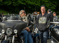 """John and Siobhan Hutchison from Weare, NH gather join fellow riders at Laconia Harley in Meredith on Thursday morning for the """"Ride to the Sky"""" with the Winnipesaukee Chapter of Harley Davidson owners group.  (Karen Bobotas/for the Laconia Daily Sun)"""