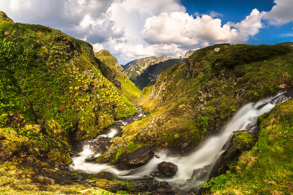 Waterfall into a mountain gorge