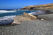 Waves breaking on beach at Playa de Garcey, Fuerteventura, Canary Islands, Spain