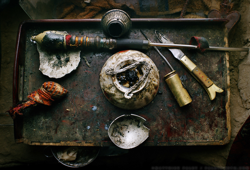 Opium kit: pipe, butter, opium, thread, funnel..Opium users inside Ooroon Boi's house, son of the Khan. Winter expedition through the Wakhan Corridor and into the Afghan Pamir mountains, to document the life of the Afghan Kyrgyz tribe. January/February 2008. Afghanistan