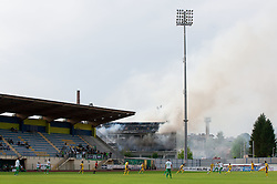 Fire during football match between NK Domzale and NK Olimpija Ljubljana in 36th, last Round of PrvaLiga 1st SNL, on May 20, 2012 in Sports park Domzale, Slovenia.  (Photo by Vid Ponikvar / Sportida.com)