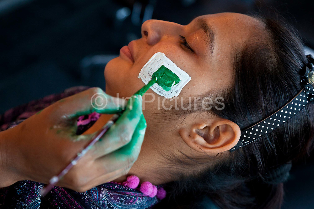 Pakistani fan having face paint applied before the start of the 2011 Cricket World Cup  match between Pakistan vs West Indies, Lahore.