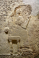 """Hittite relief sculpted orthostat stone panel  of Long Wall Limestone, Karkamıs, (Kargamıs), Carchemish (Karkemish), 900-700 BC. Anatolian Civilisations Museum.<br /> <br />  The hieroglyphics reads; """"I am Win-a-tis, beloved wife of my Lord Suhi, wherever and whenever my husband honours his name, he will honour my name as well with favours"""". Underneath, there are two goddess figures, one is naked with a horned head, holding her breasts with her hands. Her genitalia is indicated by a triangle. .<br />  <br /> If you prefer to buy from our ALAMY STOCK LIBRARY page at https://www.alamy.com/portfolio/paul-williams-funkystock/hittite-art-antiquities.html  - Type  Karkamıs in LOWER SEARCH WITHIN GALLERY box. Refine search by adding background colour, place, museum etc.<br /> <br /> Visit our HITTITE PHOTO COLLECTIONS for more photos to download or buy as wall art prints https://funkystock.photoshelter.com/gallery-collection/The-Hittites-Art-Artefacts-Antiquities-Historic-Sites-Pictures-Images-of/C0000NUBSMhSc3Oo"""