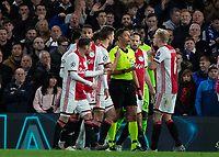 Football - 2019 / 2020 UEFA Champions League - Group H: Chelsea vs. Ajax<br /> <br /> Ajax players surround the referee before Daley Blind (Ajax FC) is sent off for a second yellow card at Stamford Bridge <br /> <br /> COLORSPORT/DANIEL BEARHAM