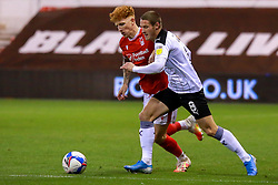 Jack Colback of Nottingham Forest and Ben Wiles of Rotherham United run down the ball - Mandatory by-line: Ryan Crockett/JMP - 20/10/2020 - FOOTBALL - The City Ground - Nottingham, England - Nottingham Forest v Rotherham United - Sky Bet Championship