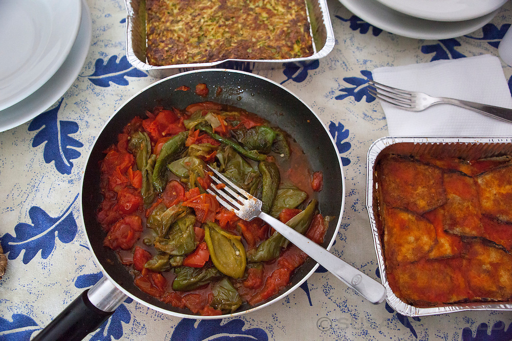Skillet full of fried peppers in Italy.