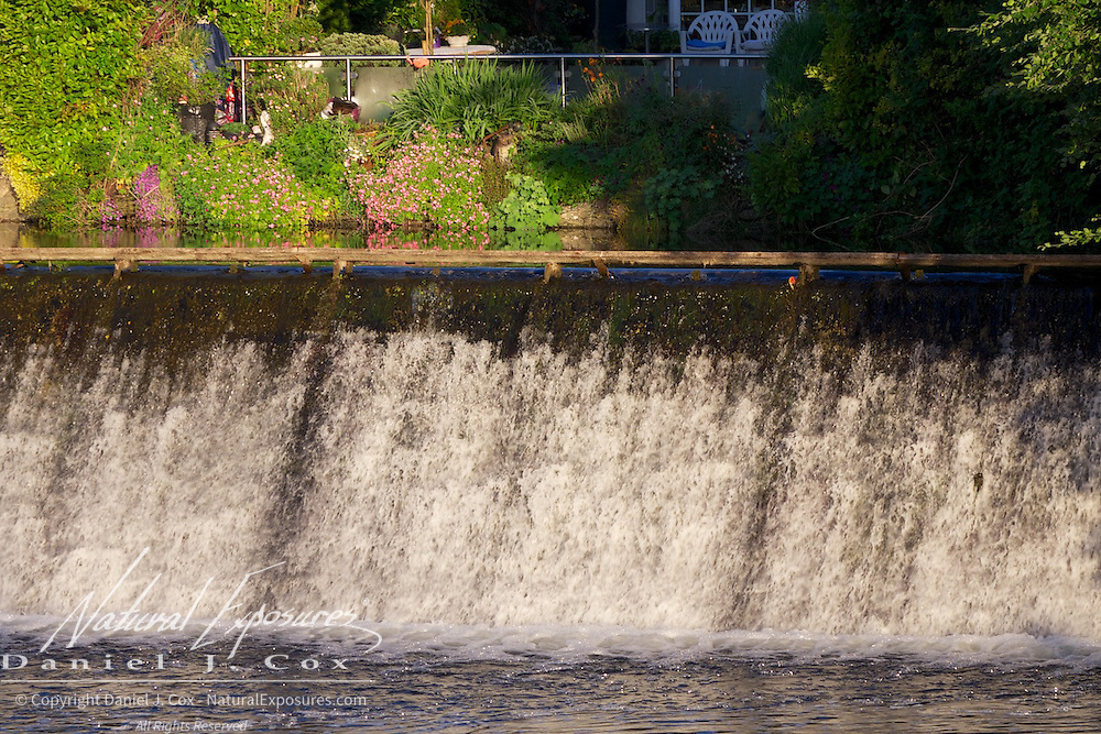 A dam holds back water on the Corrib River, Galway, Ireland,