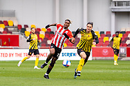 Brentford Forward Ivan Toney(#17) and Watford defender Francisco Sierralta (31) battle fro the ball during the EFL Sky Bet Championship match between Brentford and Watford at Brentford Community Stadium, Brentford, England on 1 May 2021.