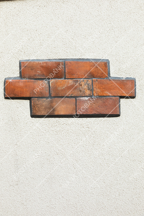 White wall background and seven dirty bricks