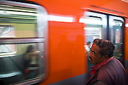 A man watches as a train enters Metro Talisman, a station on Line 4 in  Mexico City, Mexico on June 12, 2008. One of the largest systems in the world, Mexico City's subway serves nearly 5 million riders each day.