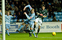 Photo: Leigh Quinnell.<br /> Coventry City v Plymouth Argyle. Coca Cola Championship.<br /> 03/12/2005. Coventrys Andy Whing and Plymouths Matt Debyshire clash in the box.