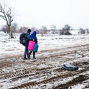 After crossing the Macedonian-Serbian border, refugees walk the unofficial refugee route in subfreezing snowy weather. Near Miratovac, Serbia, January 2016. <br /> <br /> According to UNHCR, 67,415 refugees landed in Greece in January 2016 alone, most of who traveled the route through Serbia on their way to Western Europe. The number of refugees arriving in Greece has dropped significantly since the Balkan border closures in March 2016.