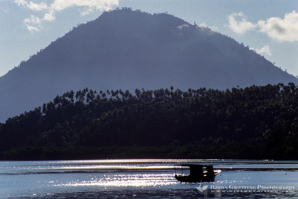 Indonesia, Sulawesi, Bunaken. Manado Tua in sunlight.
