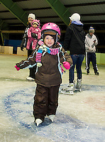 Alicia Lyman is watched by her mother Jen and younger sister Abigail as she ventures on her own during Gilford Parks and Recreation's skating party at the Arthur Tilton Ice Rink Friday evening.  (Karen Bobotas/for the Laconia Daily Sun)