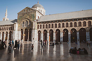Damasucs, Syria - June 3, 2010: Late afternoon scene in the courtyard of the Umayyad Mosque in Damascus. Also called the Great Mosque, it was built on the site of a Christian basilica in the 8th century.