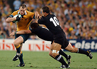 Photo. Steve Holland.Australia v New Zealand, Semi-final at the Telstra Stadium, Sydney. RWC 2003.<br />15/11/2003.<br />Stirling Mortlock left tackled by Carlos Spencer