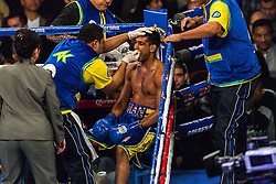 LOS ANGELES, CA - DEC 15: Former Unified Super Lightweight World Champion Amir 'King' Khan ( blue trunks) and unbeaten prospect Carlos Molina (black trunks) trade punches during their bout at the Los Angeles Memorial Sports Arena in Los Angeles, CA 2012/12/15. Amir Khan defeated Carlos Molina by TKO, after referee Jack Reiss stopped the fight after the 10th round after consulting with Molina and his corner. Byline and/or web usage link must read PHOTO: © 2012 Eduardo E. Silva/SILVEX.PHOTOSHELTER.COM.
