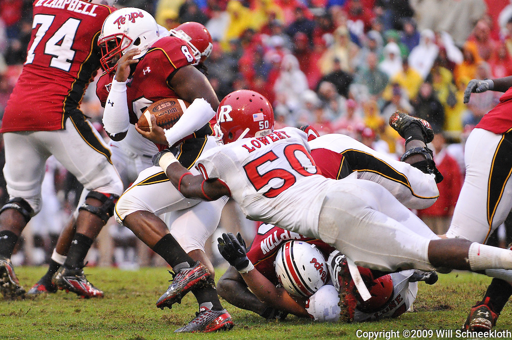 Sep 26, 2009; College Park, MD, USA;  Rutgers linebacker Antonio Lowery (50) tries to strip the ball from Maryland running back Davin Meggett (8) during the second half of Rutgers' 34-13 victory over Maryland in NCAA college football at Byrd Stadium.