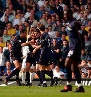 Photo. Richard Lane<br />Leeds United v Totenham Hotspurs. Barclaycard Premiership. 12/04/2003<br />Robbie Keane celebrates Spurs second goal with Gus Poyet and Darren Anderton.