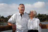 29 October 2006: Nottke Family Photo Portrait in Central Park in Huntington Beach, CA.  Grandmother and Grandfather show affection to each other during a portrait session.