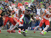 Aug 25, 2017; Seattle, WA, USA; Seattle Seahawks running back Mike Davis (39) carries the ball against the Kansas City Chiefs during a NFL football game at CenturyLink Field. The Seahawks defeated the Chiefs 26-13.
