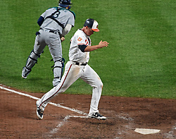 August 28, 2017 - Baltimore, MD, USA - Orioles' Trey Mancini scores the go ahead run against the Mariners in the seventh inning Monday, Aug. 28, 2017 at Oriole Park at Camden Yards in Baltimore, Md. The Orioles won, 7-6. (Credit Image: © Kenneth K. Lam/TNS via ZUMA Wire)
