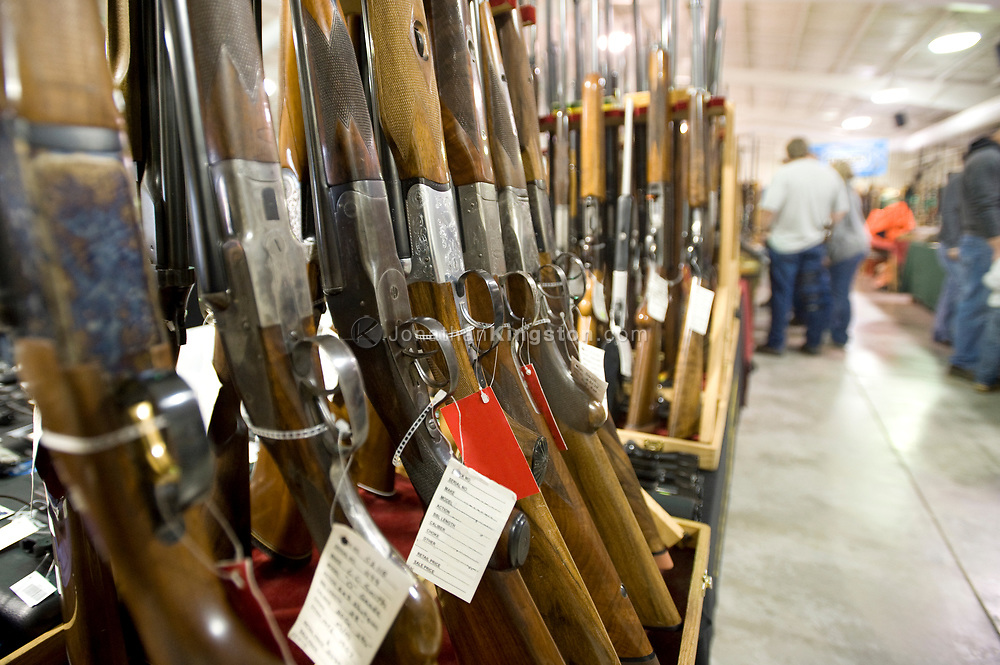 Rows of guns for sale at a gun show in Oregon. (Note: Resellers information removed from gun hang tags to protect the resellers privacy)
