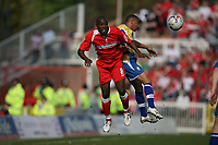 Photo: Rich Eaton.<br /> <br /> Swindon Town v Mansfield Town. Coca Cola League 2. 21/04/2007. Aaran Brown left of Swindon and Nathan Arnold right of MAnsfield go for a header