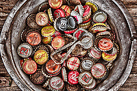 """Old Bottle Caps"" - New Mexico  I remember as a kid having a bottle cap collection. I had to hide it from my mother in my closet. I never got to photograph my collection before I eventually had to get rid of it. I wonder if I had any of these... <br /> <br /> Why do kids collect bottle caps? Do they still collect bottle caps? The person who had this nice little collection certainly wasn't a kid. I know for a fact though he is a kid at heart. This was photographed during the Santa Fe workshop Christine Hauber and I in September, 2011. Using the HDR process and CEP4 I was able to control color and detail to get exactly what I was looking for with this image - a gritty, detail rich photo with muted color around the bottle caps. A total of 56 control points were used in HDR Efex Pro to control color and brightness.Equipment: Canon 5DmkII and 24-70mm lens, tripod  Processing: 3 photo HDR. Raws were processed in Lightroom. HDR Efex Pro was used for the HDR processing. Image was then processed with Color Efex Pro 4 using Detail Extractor and Tonal Contrast. Then a small adjustment in Topaz Adjust, minor curve tweak in Photoshop, and a last run into CEP4 for Pro Contrast."
