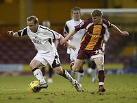 Photo: Aidan Ellis.<br /> Bradford City v Swansea City. Coca Cola League 1. 13/01/2007.<br /> Swansea's Thomas Butler (L) and Bradford's Joe Colbeck in action