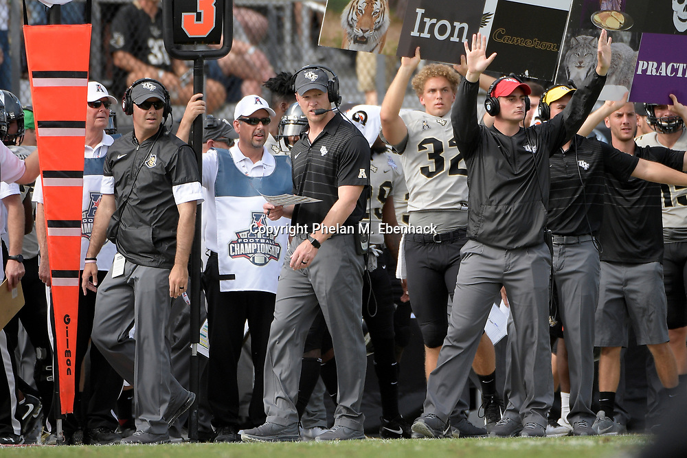 Central Florida head coach Scott Frost, center, watches from the sideline during the first half of the American Athletic Conference championship NCAA college football game against Memphis Saturday, Dec. 2, 2017, in Orlando, Fla. (Photo by Phelan M. Ebenhack)