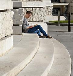 THEMENBILD - Fruehling in Wien. das Bild wurde am 15.  Maerz 2012 aufgenommen. im Bild Mann liest ein Buch auf der Treppe des Burgtheaters // THEME IMAGE FEATURE - Springtime in Vienna. The image was taken on march, 15, 2012. Picture shows Guy reading a book on stairs of Burgtheater, AUT, EXPA Pictures © 2012, PhotoCredit: EXPA/ M. Gruber