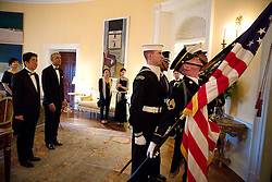 President Barack Obama and Prime Minister Shinzo Abe of Japan wait in the Yellow Oval Room to follow the Color Guard down the Grand Staircase to the State Dinner at the White House, April 28, 2015. (Official White House Photo by Pete Souza)<br /> <br /> This official White House photograph is being made available only for publication by news organizations and/or for personal use printing by the subject(s) of the photograph. The photograph may not be manipulated in any way and may not be used in commercial or political materials, advertisements, emails, products, promotions that in any way suggests approval or endorsement of the President, the First Family, or the White House.