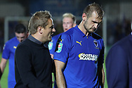 AFC Wimbledon manager Neal Ardley talking to AFC Wimbledon striker James Hanson (18) during the EFL Carabao Cup 2nd round match between AFC Wimbledon and West Ham United at the Cherry Red Records Stadium, Kingston, England on 28 August 2018.