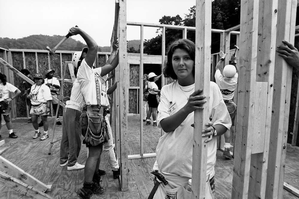 A Habitat family helping to build their home.