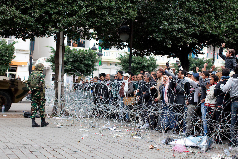 Tunis, Tunisia. January 25th 2011.Protesters on Avenue Bourguiba demand the removal of members of the ousted president's regime (Zine El Abidine Ben Ali) still in the government.....