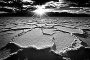 Sunset and salt formations on the dry lake at Badwater, Death Valley National Park, California