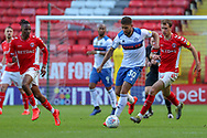 Rochdale attaker Rekeil Pyke (30) holds off Charlton Athletic midfielder Krystian Bieklik (4) and Charlton Athletic midfielder Joe Aribo (17) during the EFL Sky Bet League 1 match between Charlton Athletic and Rochdale at The Valley, London, England on 4 May 2019.
