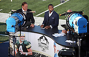 ESPN television sports analysts Chris Berman (left) and former Oakland Raiders and Green Bay Packers safety Charles Woodson do commentary on a field level broadcast booth before the Green Bay Packers 2016 NFL Pro Football Hall of Fame preseason football game against the Indianapolis Colts on Sunday, Aug. 7, 2016 in Canton, Ohio. The game was canceled for player safety reasons due to the condition of the paint on the turf field. (©Paul Anthony Spinelli)