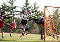 Interlakes/Moultonboro's Reagan Buhrman takes a shot to the goal against Belmont's Keagan Berry during NHIAA Division III Lacrosse Tuesday afternoon.  (Karen Bobotas/for the Laconia Daily Sun)