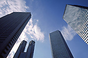 Skyscrapers surround the twin towers of the Tokyo Metropolitan Government building in Shinjuku, Tokyo, Japan March 1st 2007