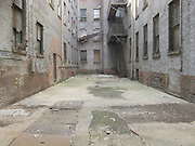 dead end alley between two parts of an old warehouse