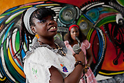 Afro-Cuban woman singing at Callejon de Hamel, a street art project in old Havana, which has a Rumba show on a Sunday afternoon, and has strong links to the Santeria religion / cult. The work is made by local Cuban artist Salvador Gonzales Escalona.